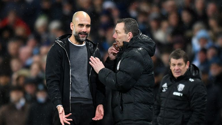 Pep Guardiola speaks with fourth official Kevin Friend following Matt Phillips' challenge on Brahim Diaz