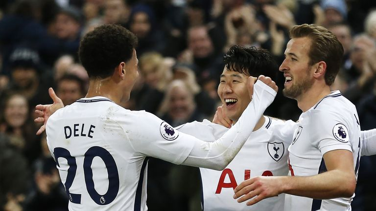 Heung-Min Son celebrates with Dele Alli and Harry Kane after scoring against Everton at Wembley Stadium