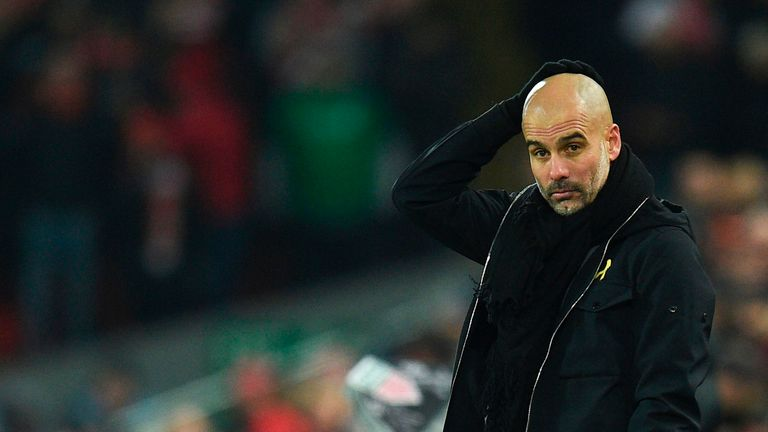 Pep Guardiola reacts on the touchline during the Premier League match between Liverpool and Manchester City at Anfield