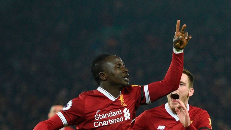 Sadio Mane (L) celebrates scoring Liverpool's third goal to extend their lead against Man City