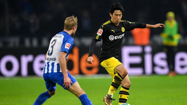 BERLIN, GERMANY - JANUARY 19: Shinji Kagawa #23 of Borussia Dortmund and Per Ciljan Skjelbreid #3 of Hertha Berlin battle for the ball during the Bundeslig