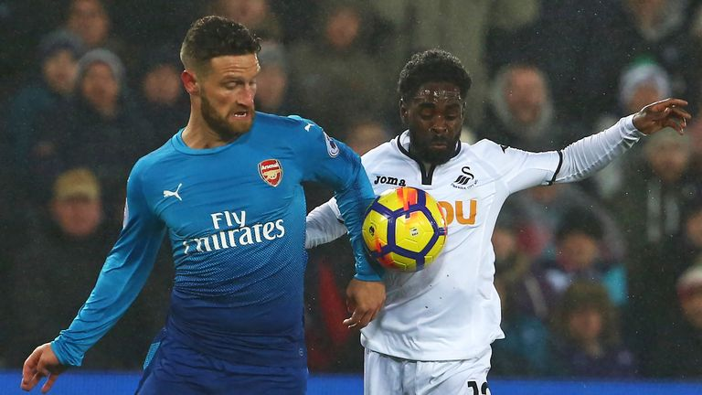 Shkodran Mustafi and Nathan Dyer in action during the at The Liberty Stadium