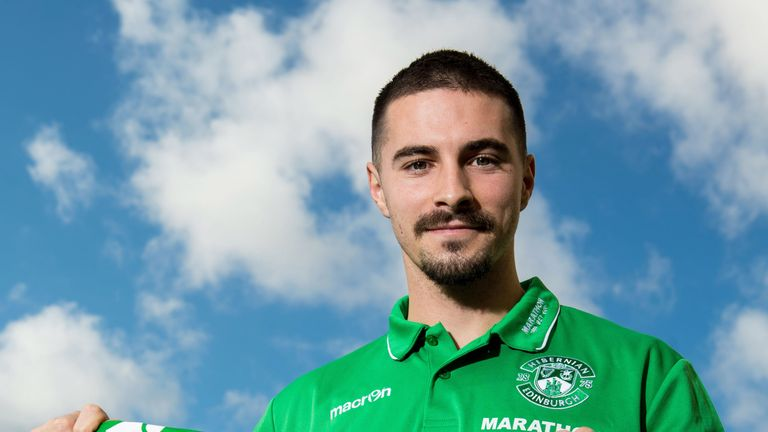 New Hibernian signing Jamie Maclaren poses for photographs after joining from SV Darmstadt 98 on loan.