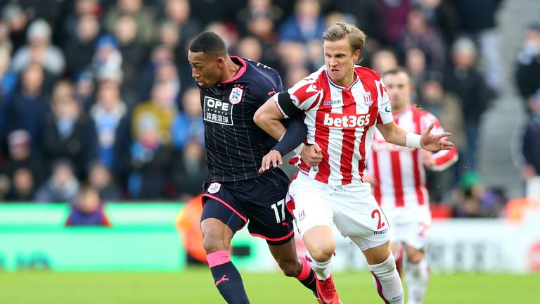 Moritz Bauer (right) in action for Stoke against Huddersfield