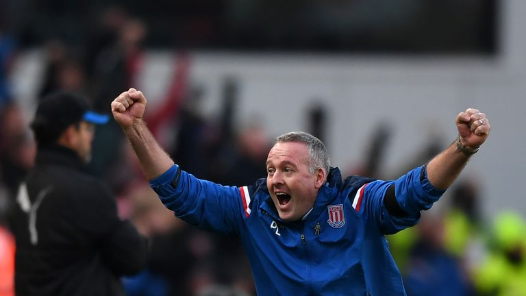 Stoke manager Paul Lambert celebrates his side's opening goal against Huddersfield