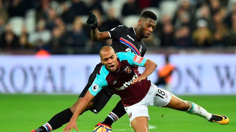 Timothy Fosu-Mensah tangles with West Ham United's on loan midfielder Joao Mario