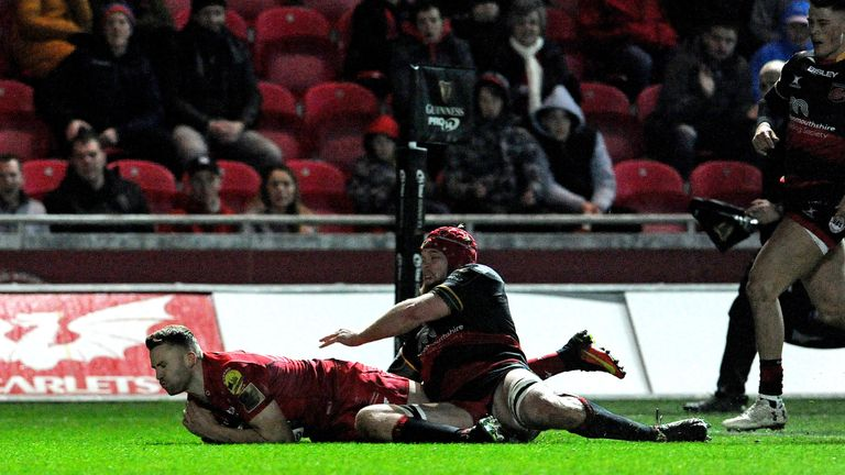 Scarlets' Tom Prydie dives on the ball for his side's second try