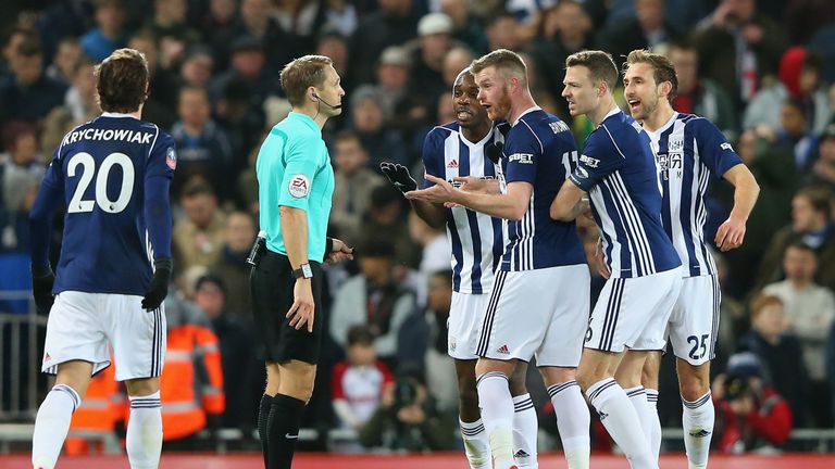LIVERPOOL, ENGLAND - JANUARY 27:  West Bromwich Albion players argue with the referee after he uses the VAR system and awards a penalty to Liverpool  durin