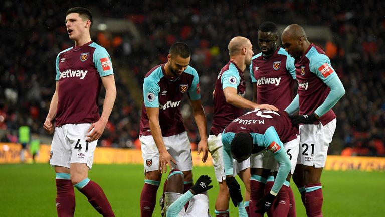 LONDON, ENGLAND - JANUARY 04:  Pedro Obiang of West Ham United (grounded) celebrates with teammates after scoring his sides first goal during the Premier L