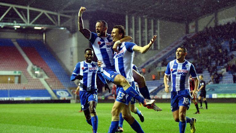 Daniel Burn celebrates scoring one of Wigan's three goals