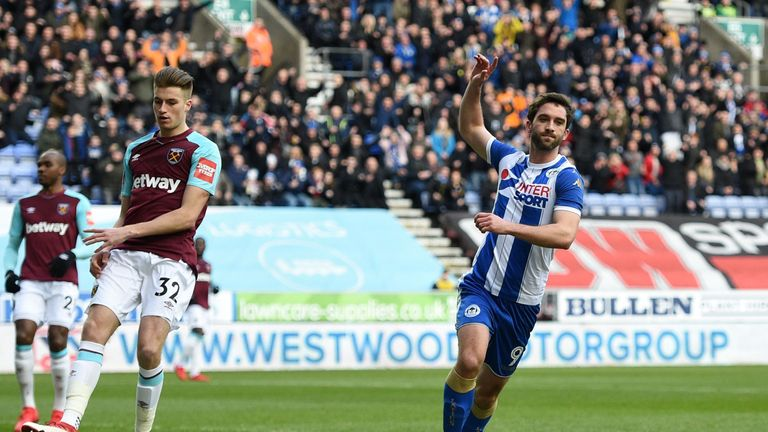 Wigan Athletic striker Will Grigg celebrates after opening the scoring against West Ham
