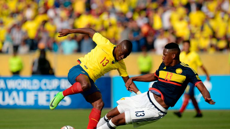 Ecuador's forward Enner Valencia (L) vies for the ball with Colombia's defender Yerry Mina during their 2018 FIFA World Cup qualifier football match in Qui