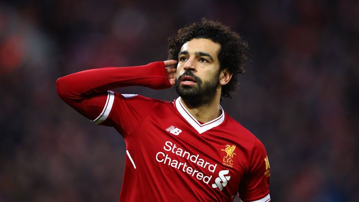 LIVERPOOL, ENGLAND - FEBRUARY 04:  Mohamed Salah of Liverpool celebrates after scoring his sides first goal during the Premier League match between Liverpo