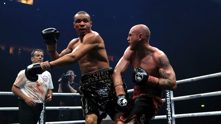 Chris Eubank (left) and George Groves (right) during the WBA Super-Middleweight title fight at the Manchester Arena.