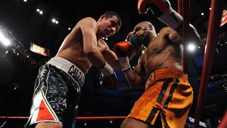 NEW YORK - NOVEMBER 08:  Joe Calzaghe of Wales (L) and Roy Jones Jr (R) exchange punches during their Ring Magazine Light Heavyweight Championship bout at
