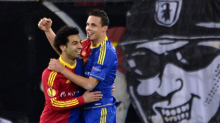 FC Basel midfielder David Degen is congratulated by team-mate Mohamed Salah during their Europa League game against Sporting Lisbon in 2012