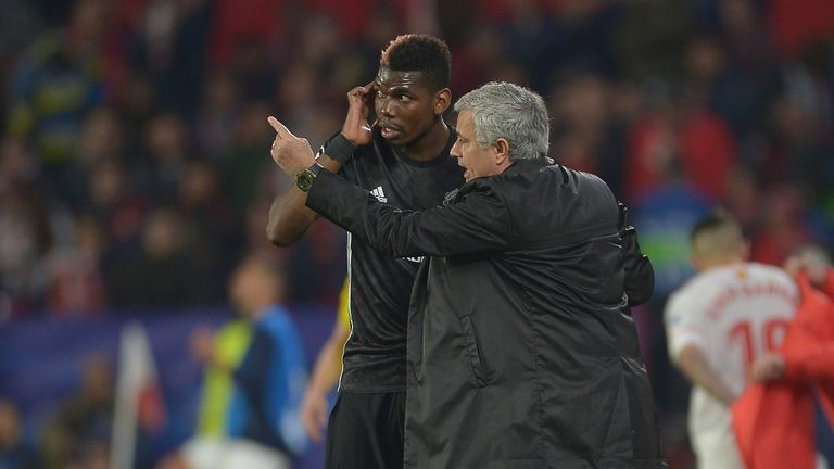 Paul Pogba takes instructions from Jose Mourinho during Manchester United's clash with Sevilla