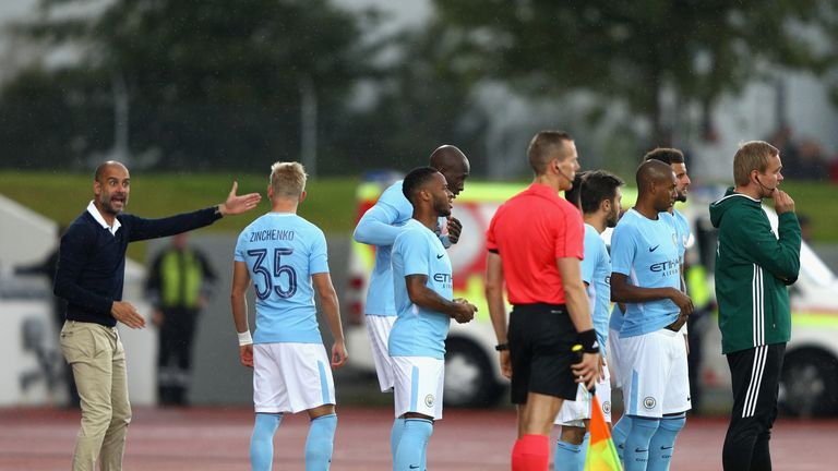 Pep Guardiola, Manager of Manchester City speaks to Oleksandr Zinchenko of Manchester City during a pre-season friendly in Iceland