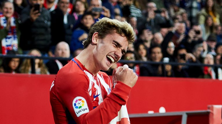 SEVILLE, SPAIN - FEBRUARY 25:  Antoine Griezmann of Atletico Madrid celebrates after scoring his team's second goal during the La Liga match between Sevill
