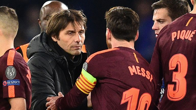 Lionel Messi shakes hands with Conte after the game
