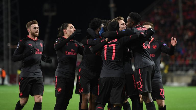 Arsenal players celebrate after scoring against Ostersunds
