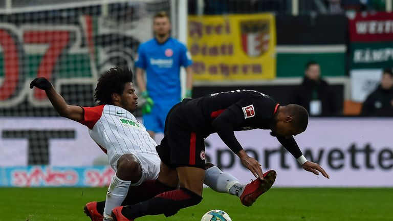 Augsburg's Caiuby tackles Frankfurt's Kevin-Prince Boateng