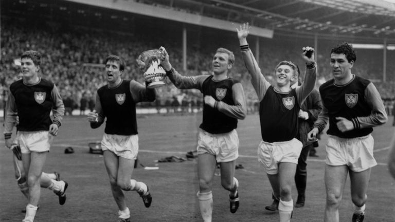 Bobby Moore (centre) celebrates winning the 1964 FA Cup with his West Ham team mates
