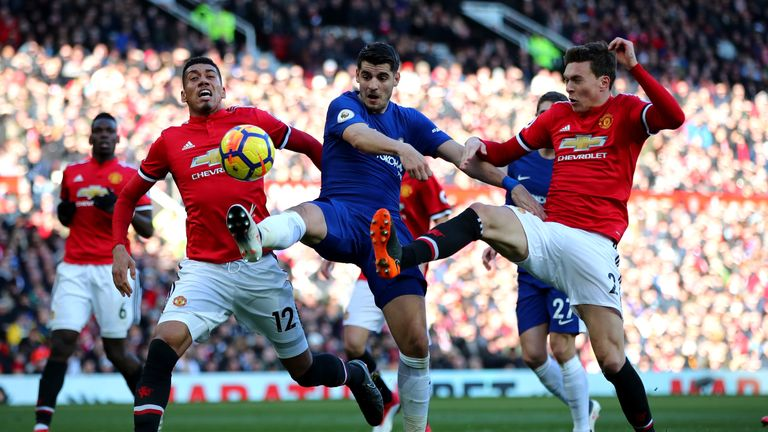 MANCHESTER, ENGLAND - FEBRUARY 25:  Alvaro Morata of Chelsea, Victor Lindelof and Chris Smalling of Manchester United compete for the ball during the Premi