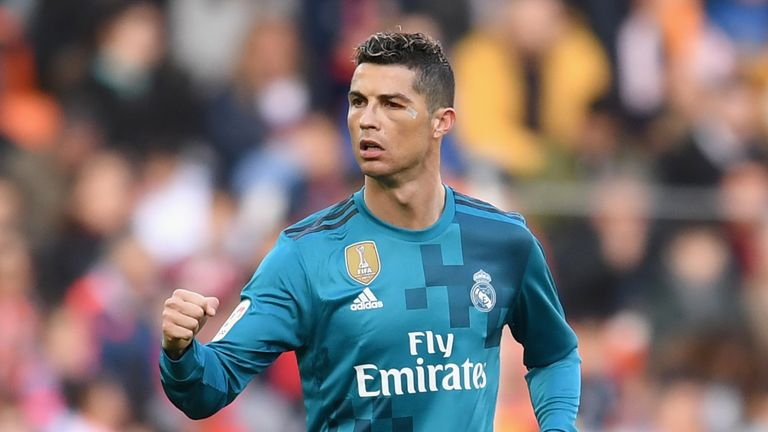 Cristiano Ronaldo of Real Madrid celebrates scoring his side's second goal from the penalty spot during the La Liga match v Valencia
