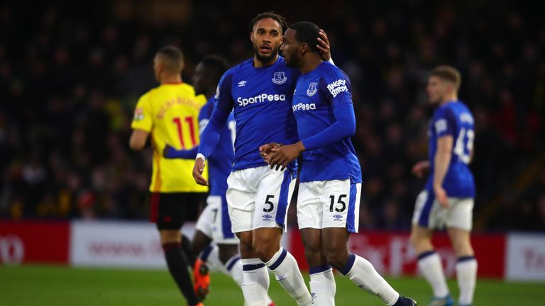 Ashley Williams and Cuco Martina of Everton speak during the Premier League match between Watford and Everton