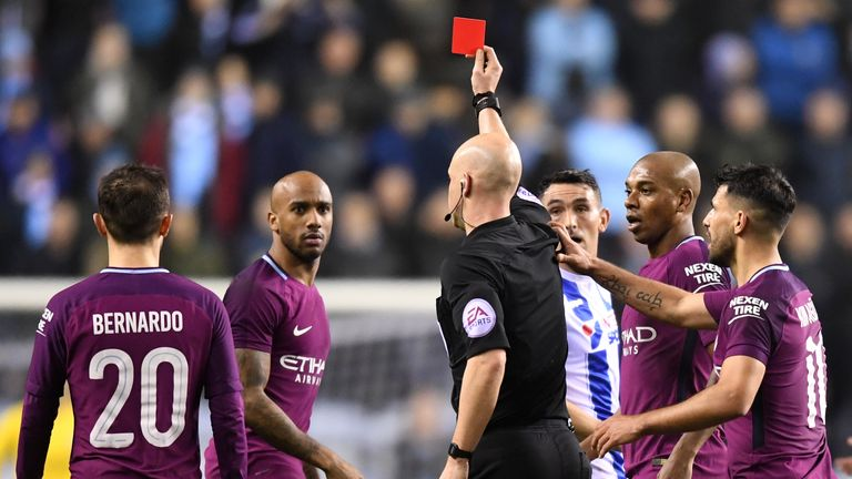 WIGAN, ENGLAND - FEBRUARY 19:  Fabian Delph of Manchester City is shown a red card by referee Anthony Taylor during the Emirates FA Cup Fifth Round match b