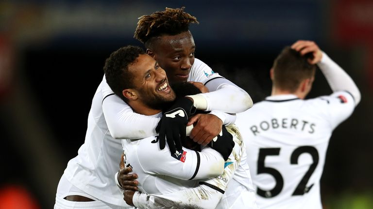Wayne Routledge celebrates scoring the 6th Swansea goal with Tammy Abraham during The Emirates FA Cup Fourth Round replay v Notts County