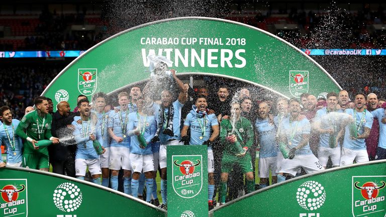 Vincent Kompany lifts the Carabao Cup trophy as Manchester City players celebrate their 3-0 victory over Arsenal