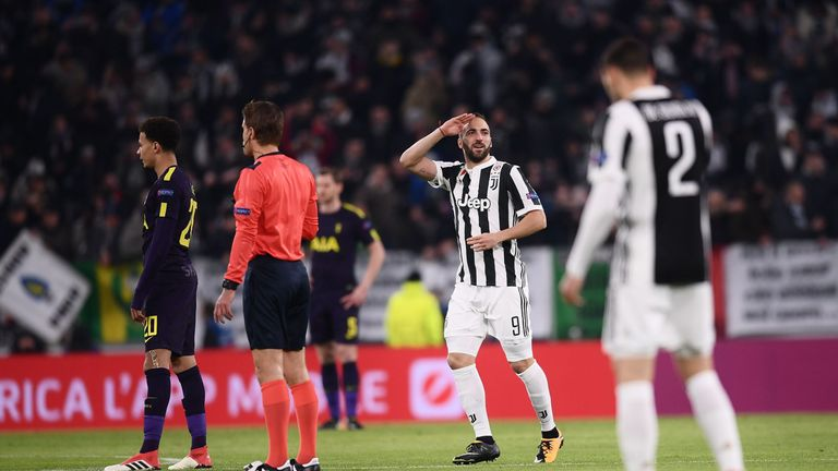 Juventus' forward from Argentina Gonzalo Higuain (C) celebrates after scoring during the UEFA Champions League round of sixteen first leg football match be