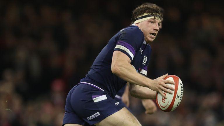 Hamish Watson of Scotland runs with the ball