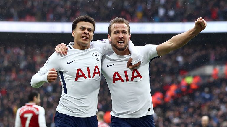 Harry Kane celebrates scoring his side's first goal of the game with Dele Alli