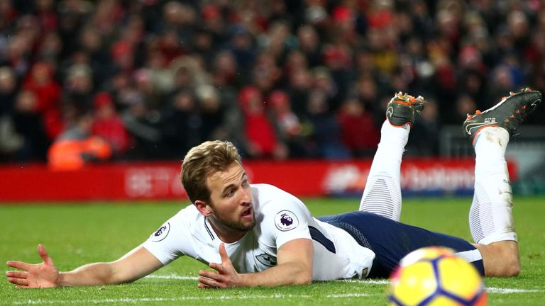 Harry Kane of Tottenham Hotspur reacts to being fouled in the penalty area during the Premier League match between Liverpool