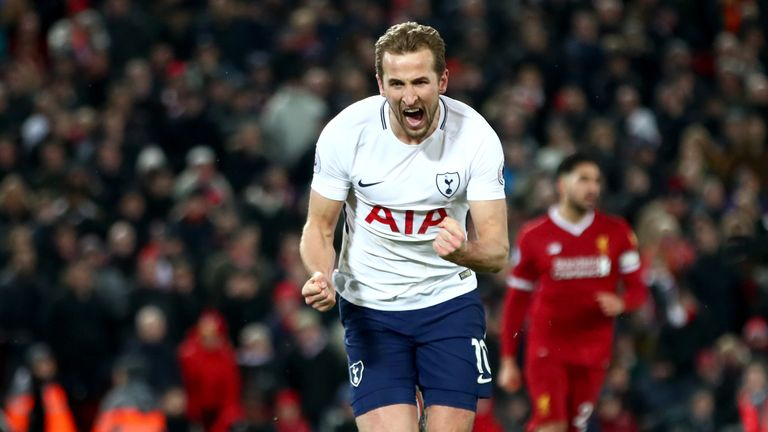 Harry Kane of Tottenham Hotspur celebrates after scoring his side's second goal and his 100th Premier League goal during the 2-2 draw at Liverpool