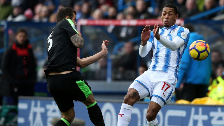 Steve Cook of AFC Bournemouth clashes with Rajiv van La Parra of Huddersfield Town during the Premier League match be