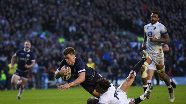 Huw Jones of Scotland scores his second try for Scotland