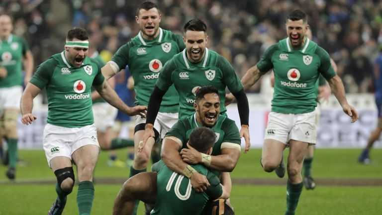 Ireland celebrate after Sexton's successful drop-goal at the last