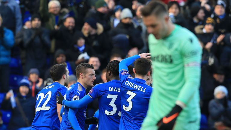 Leicester players celebrates as Stoke goalkeeper Jack Butland reacts after deflecting Marc Albrighton's cross into his own net