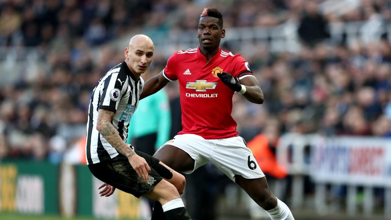 Paul Pogba of Manchester United is challenged by Jonjo Shelvey of Newcastle United during the Premier League match