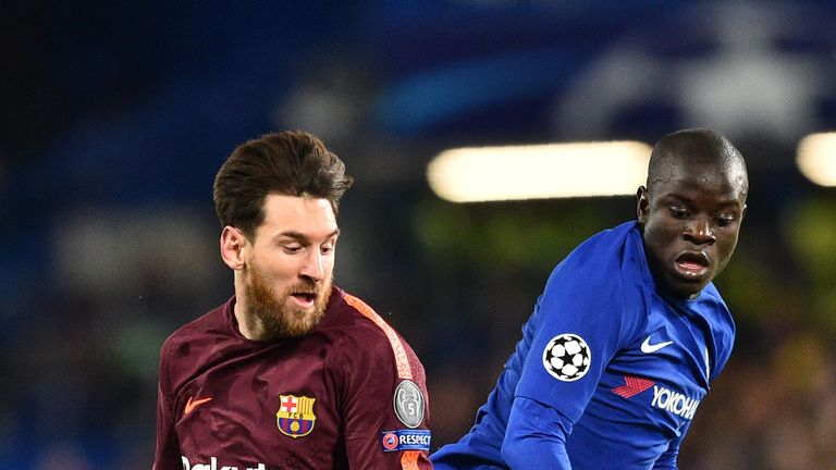 Chelsea's French midfielder N'Golo Kante (R) vies with Barcelona's Argentinian striker Lionel Messi during the first leg of the UEFA Champions League round