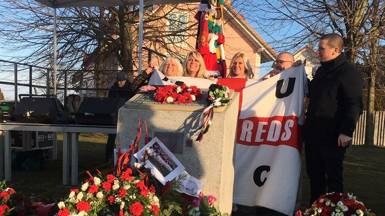 Manchester United supporters unveil a plaque upon the site of the Munich Air Disaster on the 60th anniversary