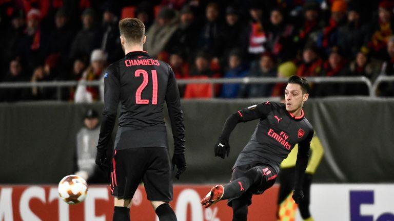 Arsenal's Mesut Özil plays the ball