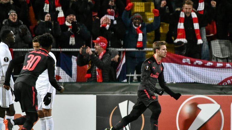Nacho Monreal celebrates after opening the scoring