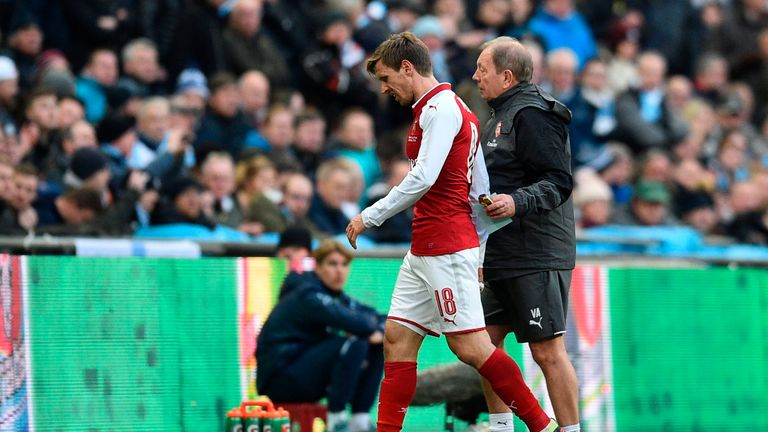 Nacho Monreal leaves the pitch injured during the Carabao Cup final between Manchester City and Arsenal