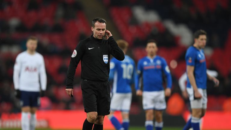 Referee Paul Tierney consults VAR and disallows a goal from Eric Lamela during the FA Cup replay between Tottenham and Rochdale