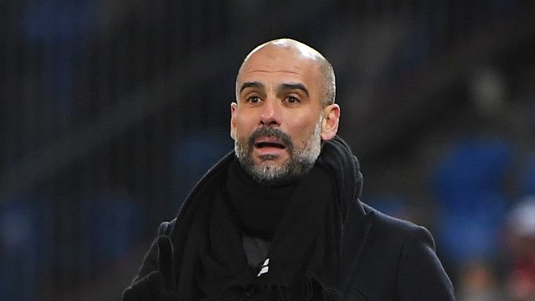 Manchester City's Spanish head coach Pep Guardiola reacts  during the UEFA Champions League round of 16 first leg football match between Basel and Manchest